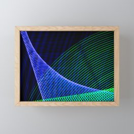 Abstract blue lights. Electricity in geometric form. Points that form patterns of lines on a black b Framed Mini Art Print
