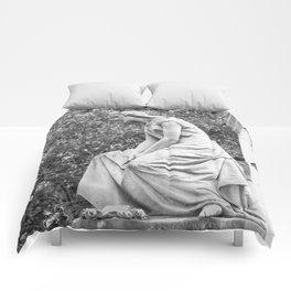 female statue Comforters