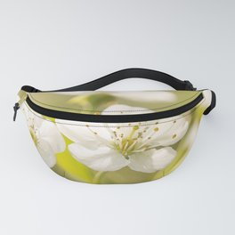 Beautiful cherry blossom on a vivid green background - summer atmosphere Fanny Pack