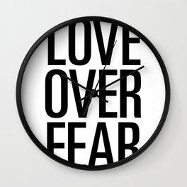 Love over fear Wall Clock