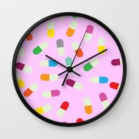 the cure Wall Clocks featuring Pill cure by  R U A L E G R E