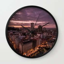Sunset over the city Wall Clock