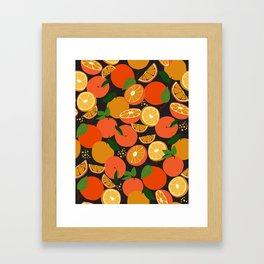 Oranges on black Framed Art Print
