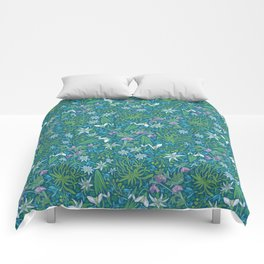 Edelweiss flowers with hellebore and snowdrops on blue background Comforters