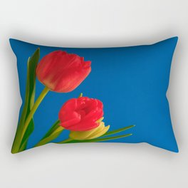 Three Tulip Flowers on Blue Background Rectangular Pillow
