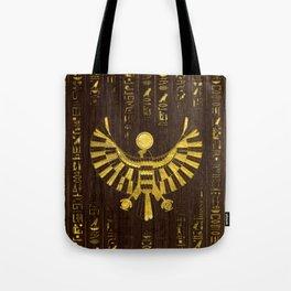Golden Egyptian Horus Falcon and hieroglyphics on wood Tote Bag
