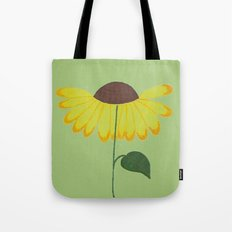 Yellow spring flower on a light green background Tote Bag