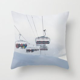 Skiers on chairlift, Alps Throw Pillow
