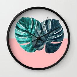 Tropical leaf on blush pink Background Wall Clock