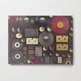 Music. Vintage wall with vinyl records and audio cassettes hung. Metal Print