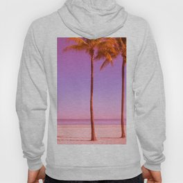 Pink faded beach with palm trees clear sky and ocean Hoody