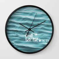 the cure Wall Clocks featuring SaltWater Cure by Christine Hall