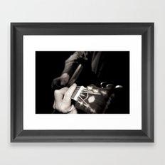 Playing the guitar Framed Art Print
