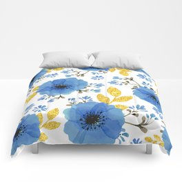 Blue flowers with golden leaves Comforters
