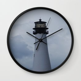 lighthouse in the skys Wall Clock