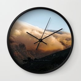 Crowned in clouds Wall Clock