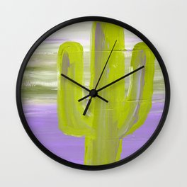 green cactus sits in front of a violet sky Wall Clock
