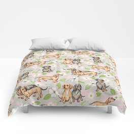 Dachshunds and dogwood blossoms Comforters