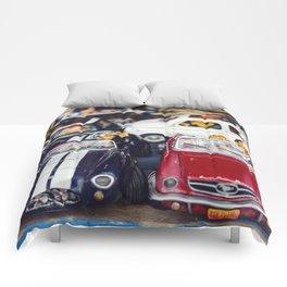 miniature retro convertible car in a shop Comforters