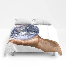 Holding planet Earth Comforters