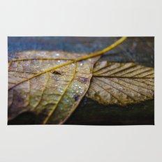Water on a fall leaf  Rug