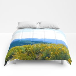yellow poppy flower field with green leaf and blue cloudy sky in summer Comforters
