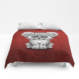 Cute Snow Leopard Cub Wearing Glasses on Deep Red Comforters