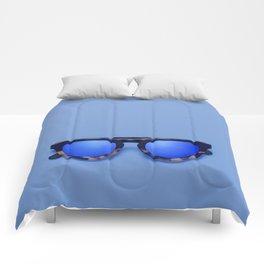 Blue Lens Sunglasses on a Blue background Comforters