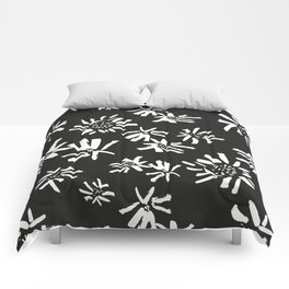 White Flowers On The Black Comforters