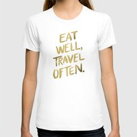 gold T-shirts featuring Eat Well Travel Often on Gold by Cat Coquillette
