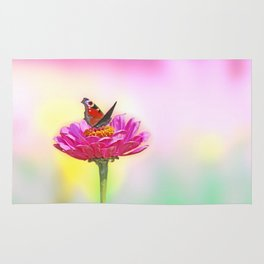 Butterfly landing on pink flower Rug
