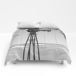 Vintage old time movie camera on a beach Comforters