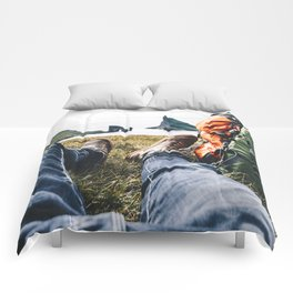 backpacker resting at faroe Comforters
