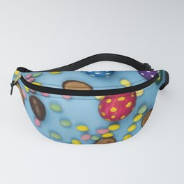 Eggs are colorful and chocolate. on a blue background. Children's sweets Fanny Pack
