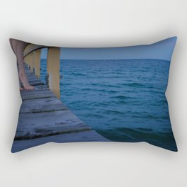 Woman standing on the edge of a pier Rectangular Pillow