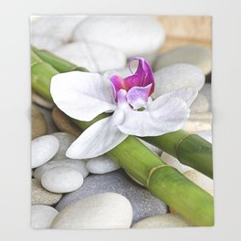 white Orchid flower  and green Bamboo still life Throw Blanket