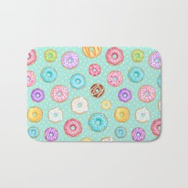 Scattered Rainbow Donuts on spotty mint - repeat pattern Bath Mat