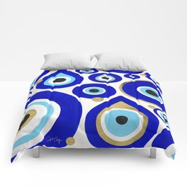 Evil Eye Charms on White Comforters