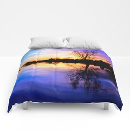 River in flood at sunset Comforters