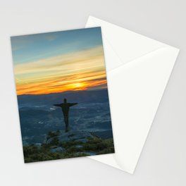 Beautiful landscape with a man on the top of a mountain at sunrise Stationery Cards