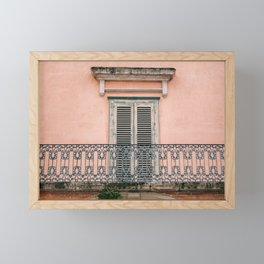 Old doors and balcony on a coral pink background in Italy Framed Mini Art Print