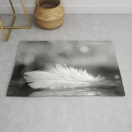 White Feather In Black And White Bokeh Background #decor #society6 #buyart Rug