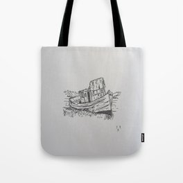 Boat on the shore Tote Bag