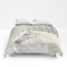 Domino in the snow Comforters