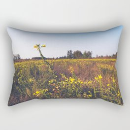 Uncultivated field in the Lomellina countryside at sunset full of yellow flowers Rectangular Pillow