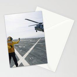 On the top deck of the USS San Diego US Navy personnel monitor a helicopter landing after an Orion u Stationery Cards
