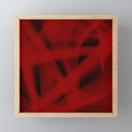 A flowing pattern of smooth red lines on a dark veil with transparent luminous transitions. Framed Mini Art Print