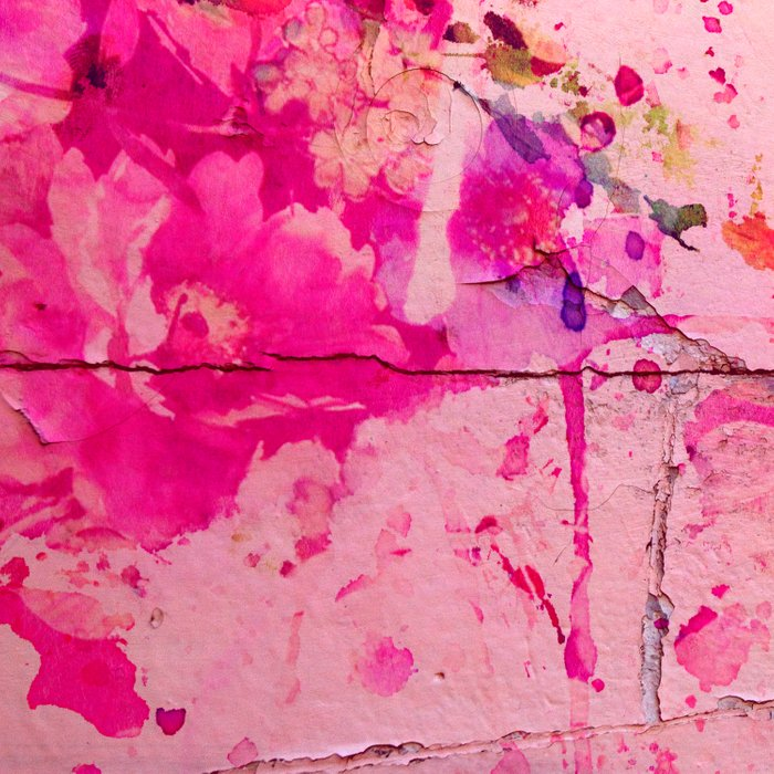 pink floral on crumbling wall Comforters