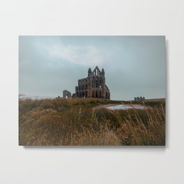 The ruins of church Whitby Abbey on top of a vast hill Metal Print