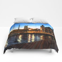 Sunset and citylights in the port of Barcelona Comforters